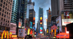 The iconic Times Square buzzes all night. Wikimedia Commons/Terabass image