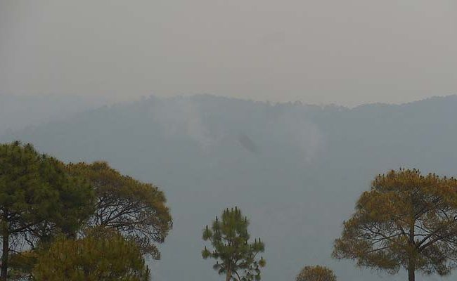 Fire smoke easily visible by the ranikhet hillsides
