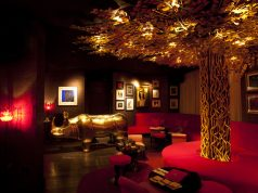 The reception red and gold combination sets the tone for the hotel at Vagabond Singapore